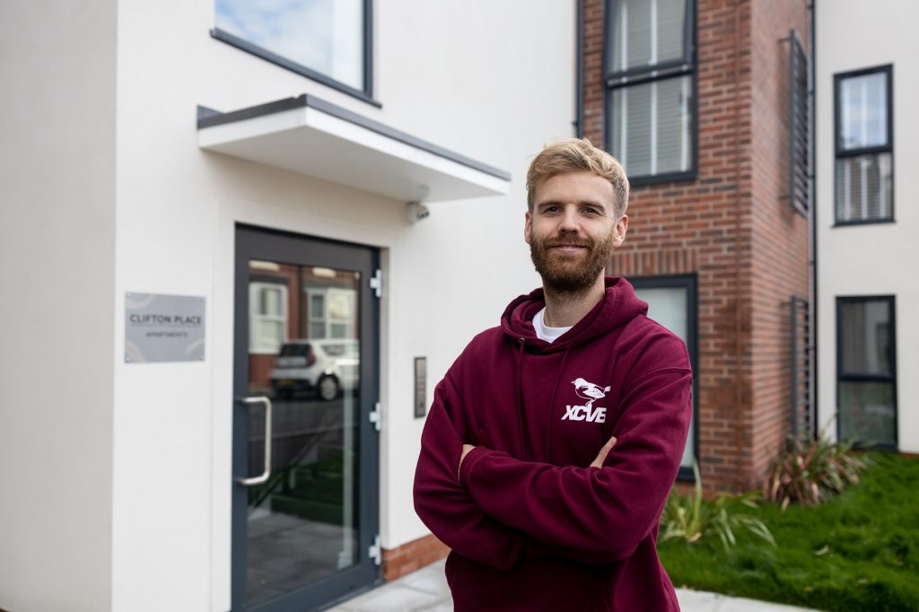 Chris outside his shared ownership home in Liverpool