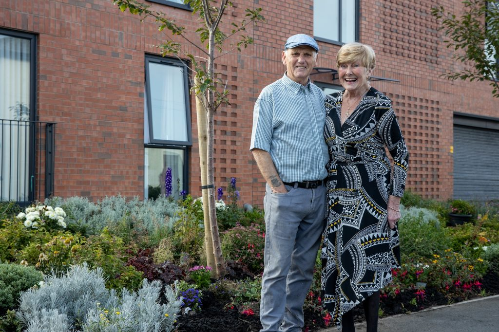 Fred and Ann outside their shared ownership apartment in New Brighton