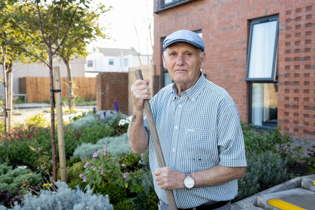 Fred in the Garden outside his shared ownership home in New Brighton