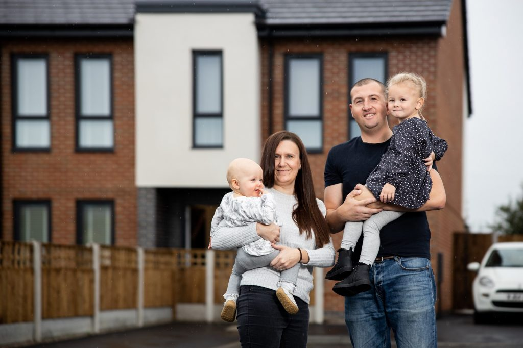 Kristian & Gillian outside their shared ownership home in Whitefield