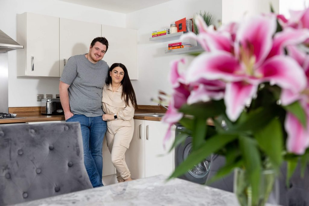 Shared ownership purchasers in their kitchen at Sycamore Gardens