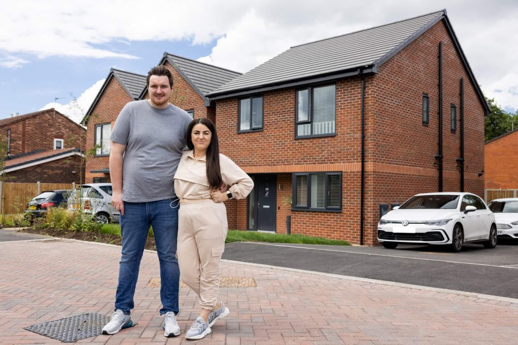 Shared ownership purchasers outside their home at Sycamore Gardens